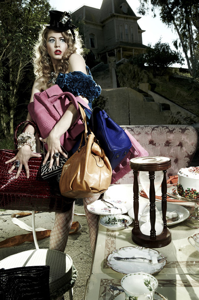 """Andre thinks that she looks """"absolutely mad"""" in her tea party-themed photo, joking that it's almost as though she is trying to sneak away from the party with a bunch of handbags. Tyra calls it """"absolutely fantastic"""" but points out the entire film wasn't strong. She advises Hannah to work on her timing so that she is giving her best when the photographer clicks."""